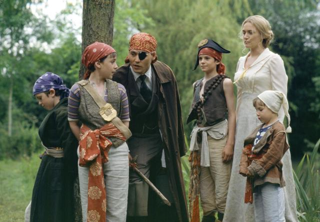 still-of-johnny-depp-kate-winslet-and-freddie-highmore-in-finding-neverland-2004-large-picture